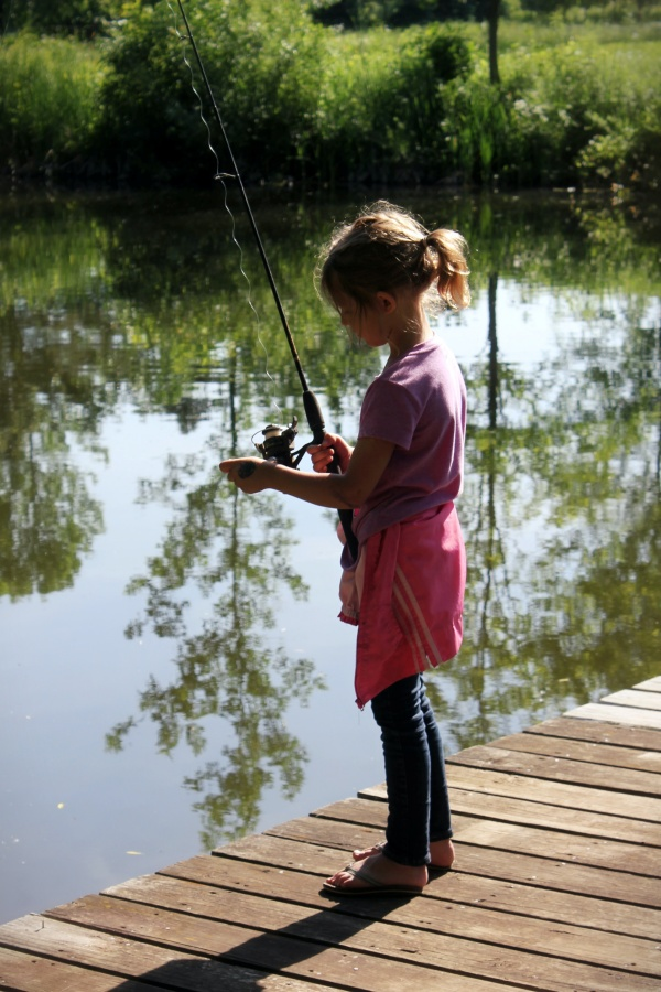 Girl fishing with selfmade rod by Sheri Hooley